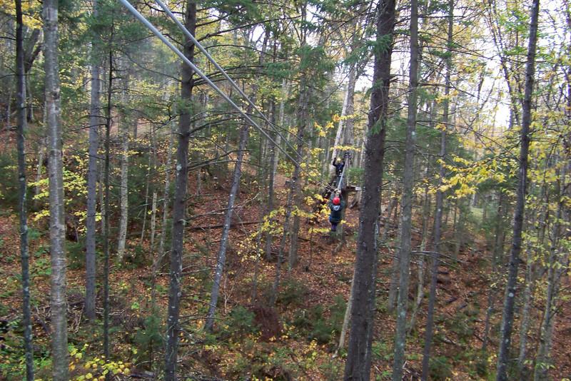 Jeane practices on a short zipline.