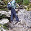 Scramble is an accurate word; the trail is largely boulders from here on.