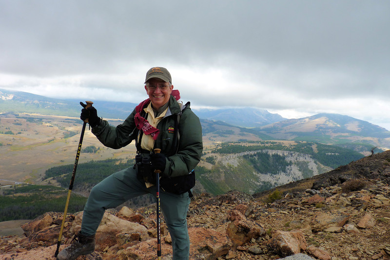 Jeane works hard to avoid being blown off of Bunsen Peak by the powerful wind.