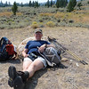We stop for a snack break before the long, hot walk across the sagebrush flats.