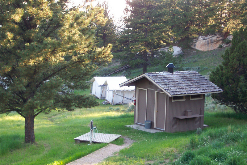 A view of the tent camp at the Tensleep Preserve, with a more-posh-than-usual latrine.