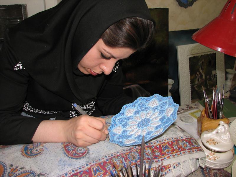 Enamelled copper-sheet artist at work (handycraftsmen Esfahan)