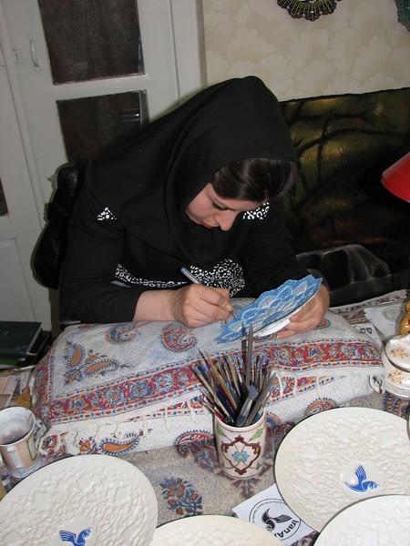 enamelled copperware artist at work (handycraftsmen Esfahan)