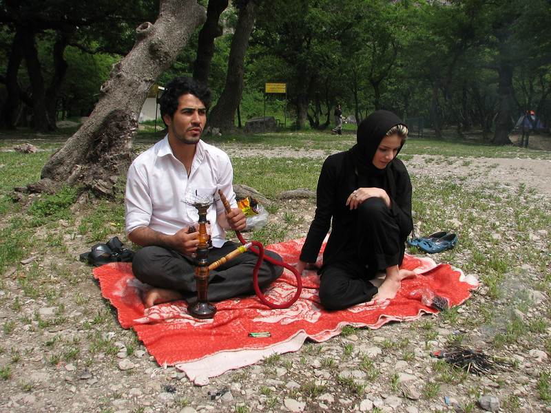 a young couple smoking the waterpipe (Golestan National Park, N Iran)