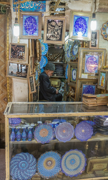 Enameled copperware and a handicraft seller.