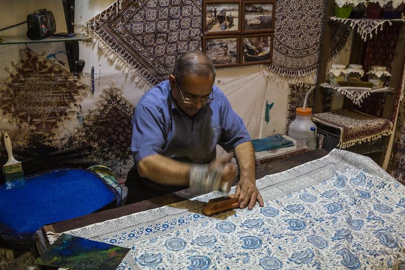 Handycraftsmen, with wooden stamps, textile printing