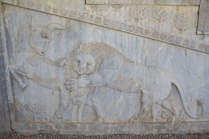Bas-relief in Persepolis—a symbol in Zoroastrian for Nowruz— eternally fighting bull (personifying the moon), and a lion (personifying the Sun) representing the Spring.