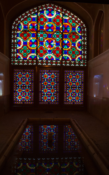 A window inside the structure under the windcatcher of Dowlat Abad Garden