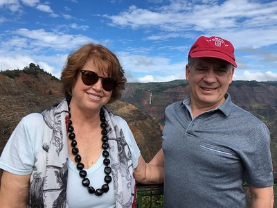 Nancy and Steve posing in front of Wimea Canyon and thw waterfalls we hiked.