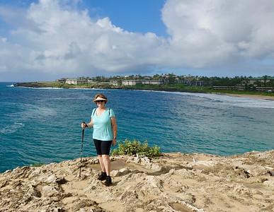 Nancy is adventurous hiking near a cliff on Maha'ulepu Heritage Trail.