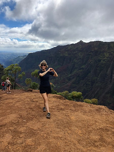 Tabitha gets in some yoga near a steep cliff.  We were only a little scared watching her.