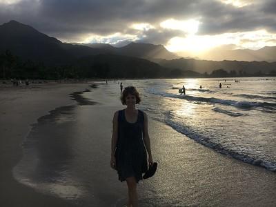 Tabitha takes a walk on the beach during sunrise.