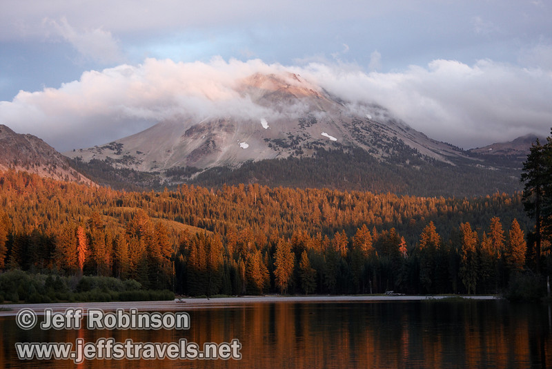 Lassen Peak in clouds over Manzanita Lake, with late sun hitting the trees on the far side of the lake and a little on Lassen Peak (9/5/2009)