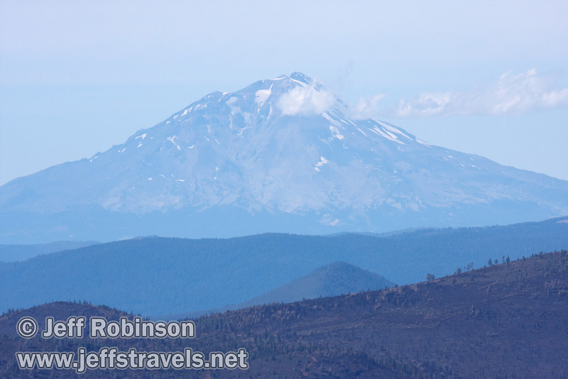 Mount Shasta with clouds slightly obscuring the top (9/6/2009, Hat Creek Rim hike, Pacific Crest Trail near 44/89 junction)