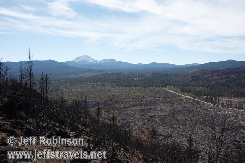 Lassen Peak and Chaos Crags over Hat Creek Valley. The recent burn is evident up to the highway 44/89 junction in this photo. (9/6/2009, Hat Creek Rim Vista Point, near 44/89 junction)