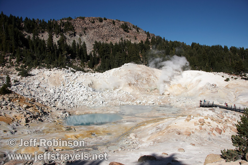 People on the boardwalk looking at the yellow sulfur on the ground, a milky blue pool, and steam plumes rising from vents at Bumpass Hell (9/7/2009, Bumpass Hell Trail, Lassen NP)