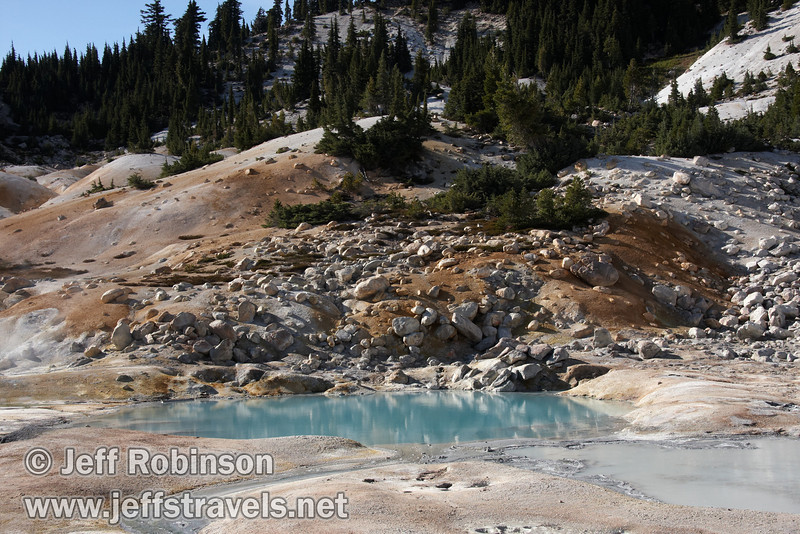 Blue pool at Bumpass Hell with orange & white ground and green tree behind it (9/7/2009, Bumpass Hell Trail, Lassen NP)