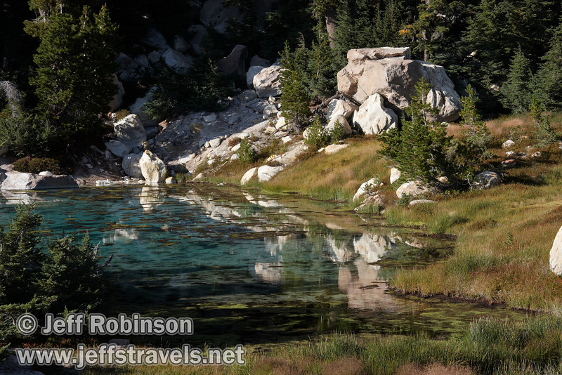 Rocks reflected in a turquoise blue pool at the end of the current boardwalk. (Note: On my previous trips in 2000 and 2001, the boardwalk ended significantly short of here) (9/7/2009, Bumpass Hell Trail, Lassen NP)