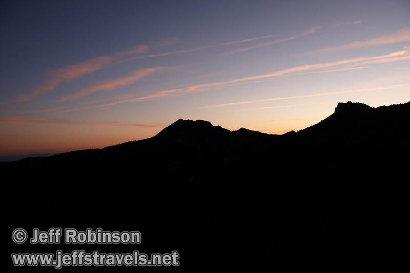 Sunset colors behind the profile of what is likely Brokeoff Mountain (L) and Mt. Diller (R) (9/7/2009, Bumpass Hell Trail, Lassen NP)