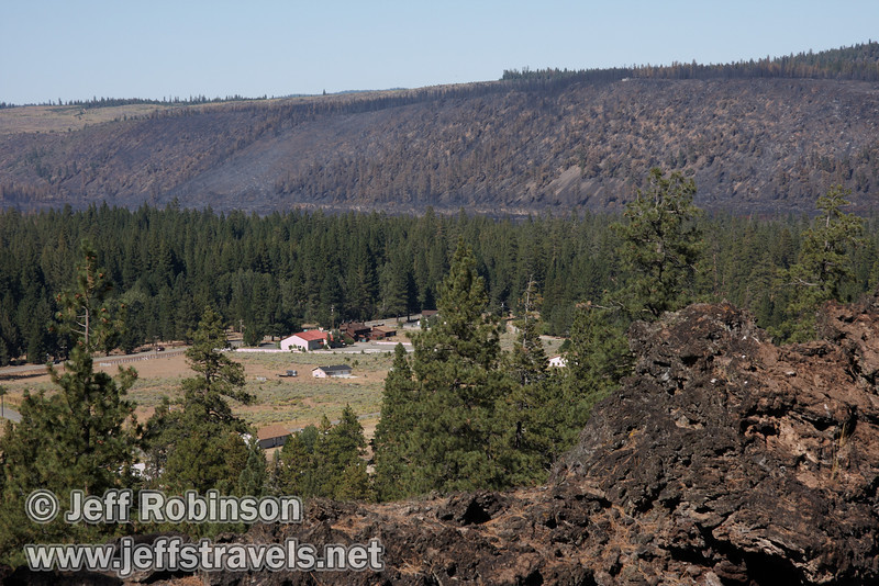 The buildings of Old Station and the recently burned area leading up to the Hat Creek Rim seen over Deep Cone at marker 10 (9/8/2009, Spatter Cones Nature Trail, Lassen NF)