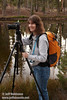 Lynda smiling for a photo by her camera on a tripod (9/8/2009, Reflection Lake, Lassen NP)