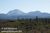 Lassen Peak (L) and Chaos Crags (R) seen over the brush and trees from marker 14 (9/8/2009, Spatter Cones Nature Trail, Lassen NF)