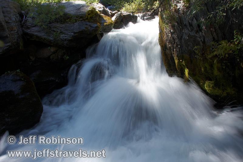 Closeup of a mini-waterfall pouring through rocks on Kings Creek (9/10/2009, Kings Creek Falls hike, Lassen NP)