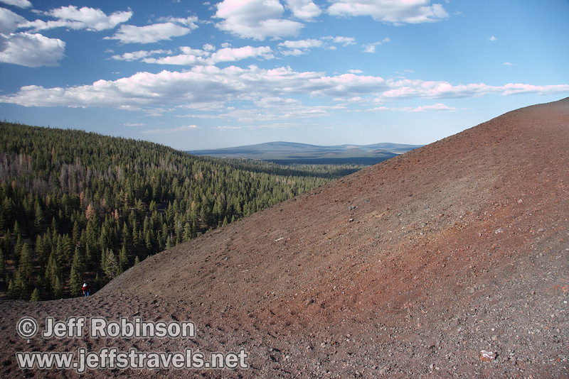 The red rock on Cinder Cone at the top of the trail, with Lynda just appearing on the trail below (9/11/2009, Cinder Cone hike, Lassen NP)