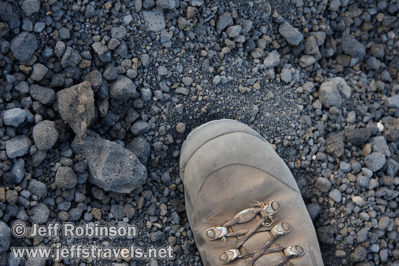 Photo of the rock & gravel that makes up the Cinder Cone trail, with my boot for size reference (9/11/2009, Cinder Cone hike, Lassen NP)