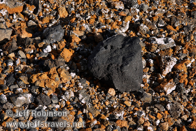 Close up of larger black rock amongst the orange rock on the top of Cinder Cone (9/11/2009, Cinder Cone hike, Lassen NP)