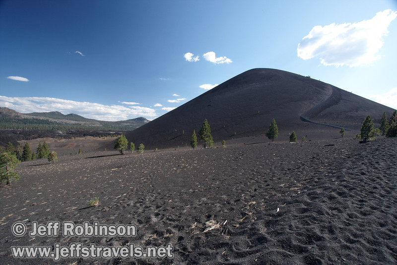 Cinder Cone and the 22 degree trail going up it, with the Painted Dunes (mid-ground) and the Fantastic Lava Beds (background) in front of mountains to its left (9/11/2009, Cinder Cone hike, Lassen NP)