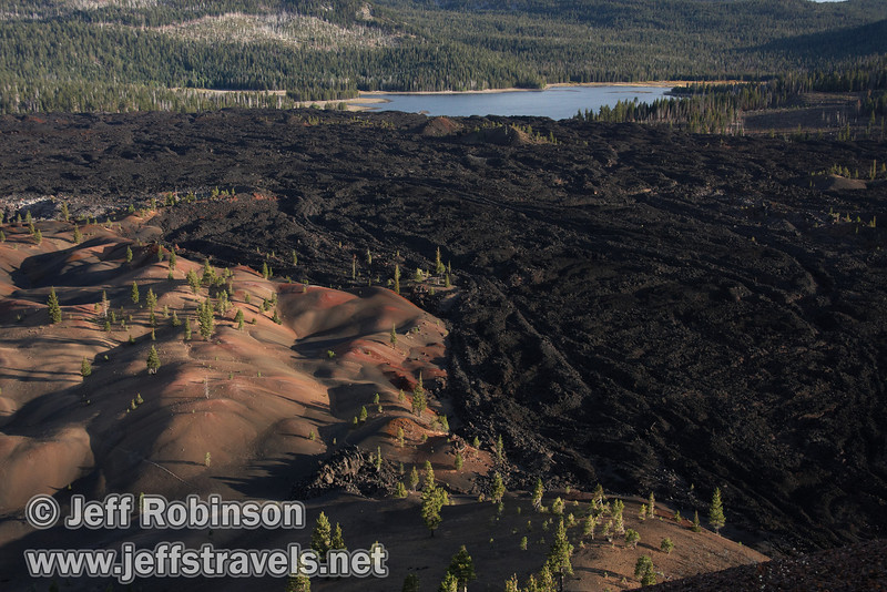Late sun highlights the texture of the Fantastic Lava Beds next to the Painted Dunes, with Snag Lake in the background (9/11/2009, Cinder Cone hike, Lassen NP)