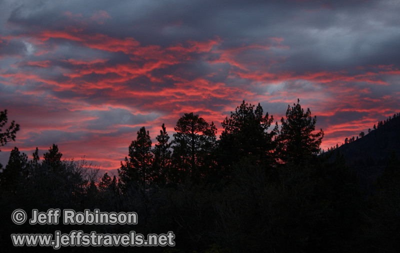 brilliant red sunset over trees, seen from the trail to Subway Cave (9/12/2009, Subway Cave, Lassen NF, CA)