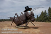Cricket or grasshopper with a top hat and glasses (9/12/2009, sculptures at Packway Materials Inc., 22246 Cassel Rd. Cassel, CA)