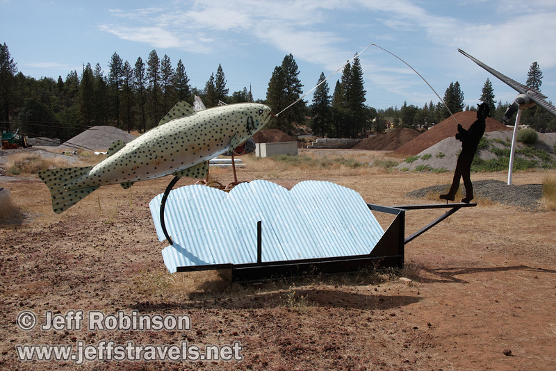 Fisherman who with a fish he hooked (9/12/2009, sculptures at Packway Materials Inc., 22246 Cassel Rd. Cassel, CA)