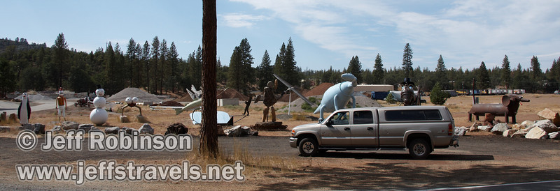 My truck parked in front of the giant sculptures (9/12/2009, sculptures at Packway Materials Inc., 22246 Cassel Rd. Cassel, CA)