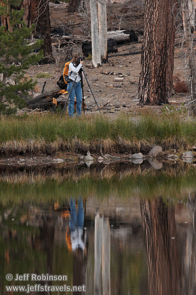 Lynda taking photos on the far shore with her camera on a tripod, with her reflection (9/8/2009, Reflection Lake, Lassen NP)