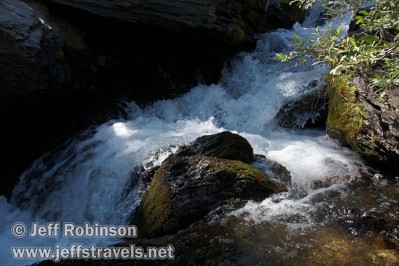 Closeup of a mini-cascade pouring over rocks on Kings Creek (9/10/2009, Kings Creek Falls hike, Lassen NP)