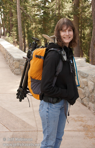 Lynda smiling for a photo with her pack and tripod at the trail head (9/10/2009, Kings Creek Falls hike, Lassen NP)