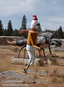 Snow skier, with dragon fly and chicken hawk? behind (9/12/2009, sculptures at Packway Materials Inc., 22246 Cassel Rd. Cassel, CA)