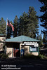 The Old Station Post Office with an American Flag above it and trees behind it (9/8/2009, Hat Creek Resort & RV Park, Lassen NF)