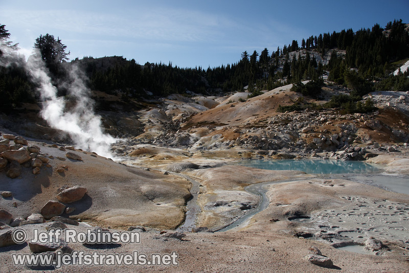 View up the Bumpass Hell valley with white, yellow, & orange ground, a blue pool, and steam (9/7/2009, Bumpass Hell Trail, Lassen NP)