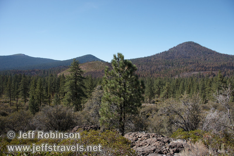 View of Logan Mountain (L),  Wilcox Peak (C) and Sugarloaf Peak (R) over a lava lobe (9/8/2009, Spatter Cones Nature Trail, Lassen NF)