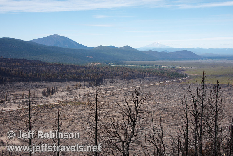 Burney Mountain (left) and Mount Shasta (distant right). The recent burn around highway 89 is evident in this photo. (9/6/2009, Hat Creek Rim Vista Point, near 44/89 junction)