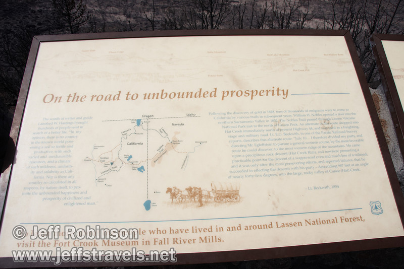 """On the road to unbounded prosperity"" sign. Vista mountain identification on top. (9/6/2009, Hat Creek Rim Vista Point, near 44/89 junction)"
