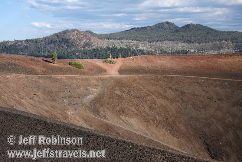 View of the trails on the south side of the top of Cinder Cone, with mountains in the background (9/11/2009, Cinder Cone hike, Lassen NP)