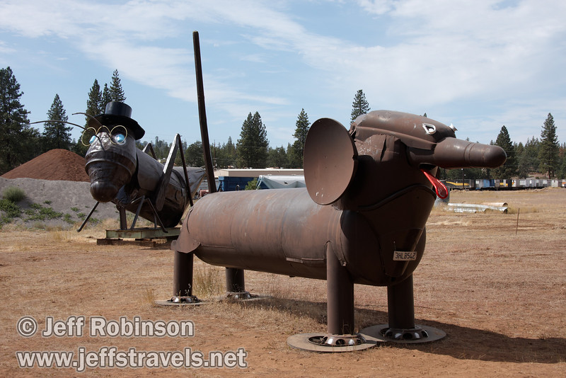 Dachshund, with cricket or grasshopper in background (9/12/2009, sculptures at Packway Materials Inc., 22246 Cassel Rd. Cassel, CA)