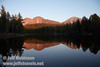 Late sun on Chaos Crags (L) and Lassen Peak (R) with their reflection in the lake (9/8/2009, Reflection Lake, Lassen NP)