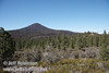 View of Sugarloaf Peak with its recent fire, and a house with a spectacular view on top of a hill (9/8/2009, Spatter Cones Nature Trail, Lassen NF)
