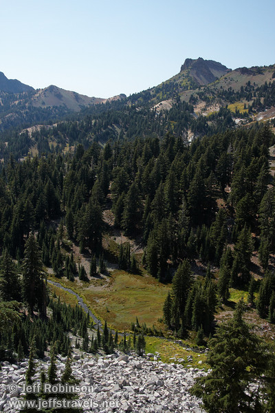 Mill Creek (or something that feeds into Mill Creek)in an alpine valley with trees and green & yellow plants. Wide shot including background peaks. (9/7/2009, Bumpass Hell Trail, Lassen NP)